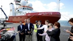 Australian Federal Infrastructure and Transport Minister Darren Chester, third left, holds a press conference in Perth, Australia, with Malaysian Transport Minister Liow Tiong Lai, left, and other officials in front of the search ship Fugro Equator, one of the vessels involved in the MH370 search, on Monday, Jan. 23, 2017. (Richard Wainwright / AAP Image)
