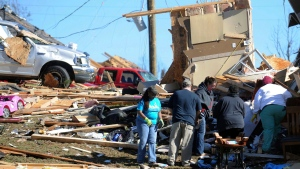 Residents of Petal, Miss., continue with cleanup from Saturday's twister that damaged much of the city, Sunday, Jan. 22, 2017. Saturday's tornado also destroyed a portion of southern Hattiesburg. (Ryan Moore/WDAM-TV, via AP)