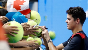 Milos Raonic signs autographs at the Australian Open tennis championships in Melbourne, Australia, on Jan. 23, 2017. (Dita Alangkara / AP)
