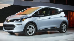 The Chevrolet Bolt drives onstage during a press conference at the 2017 North American International Auto Show in Detroit, Michigan,on Jan. 9, 2017. (Geoff Robins / AFP)