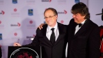 Music Producer Bob Ezrin, left, and former president and CEO of Universal Music Canada Randy Lennox, right, pose for a photo during Ezrin's induction ceremony into Canada's Walk of Fame in Toronto on Sept. 21, 2013. (Michelle Siu/The Canadian Press)