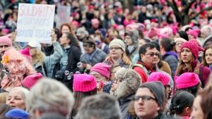 Emily Phonelath blows bubbles while in the crowd of the Women's March on Washington in Washington D.C. on Saturday, Jan. 21, 2017. (Aileen Devlin /The Daily Press via AP)