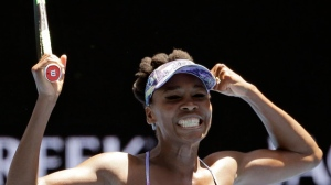 United States' Venus Williams celebrates after defeating Russia's Anastasia Pavlyuchenkova during their quarterfinal at the Australian Open tennis championships in Melbourne, Australia, Tuesday, Jan. 24, 2017. (AP Photo/Aaron Favila)
