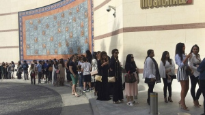 Kim Kardashian West's fans queue for attending her make-up masterclass at Musichall in Dubai, United Arab Emirates on Friday, Jan.13, 2017. (AP / Kamran Jebreili)