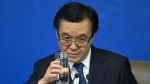 Chinese Commerce Minister Gao Hucheng raises a glass of water at a press conference during the National People's Congress in Beijing, Saturday, March 7, 2015. (AP / Ng Han Guan)