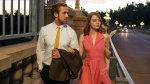 This image released by Summit Entertainment shows Ryan Gosling, right, and Emma Stone in a scene from 'La La Land.'