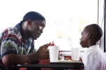 "This image released by A24 Films shows Mahershala Ali, left, and Alex Hibbert in a scene from, ""Moonlight."" Ali was nominated for an Oscar for best supporting actor on Tuesday, Jan. 24, 2017, for his work in the film. The 89th Academy Awards will take place on Feb. 26. (David Bornfriend/A24 via AP)"