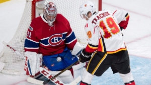 Montreal Canadiens goalie Carey Price (31) stops a shot from Calgary Flames left wing Matthew Tkachuk (19) during second period NHL hockey action Tuesday, January 24, 2017 in Montreal. THE CANADIAN PRESS/Paul Chiasson