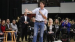 Prime Minister Justin Trudeau takes questions at a town hall meeting in Calgary, Alta. on Tues., Jan. 24, 2017. (Jeff McIntosh / THE CANADIAN PRESS)