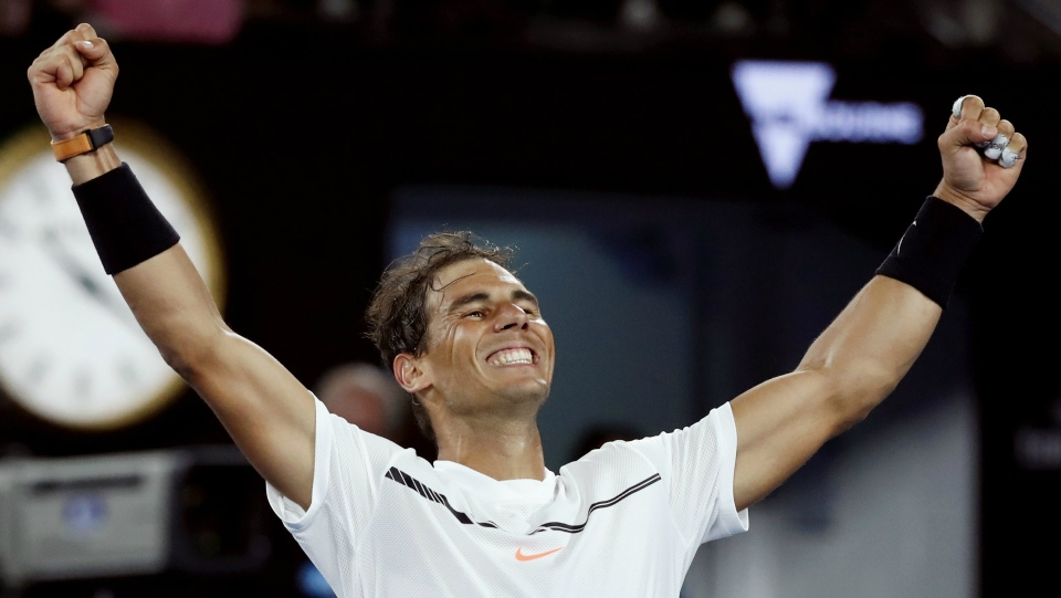 Spain's Rafael Nadal celebrates after defeating Canada's Milos Raonic during their quarterfinal at the Australian Open tennis championships in Melbourne, Australia, Wednesday, Jan. 25, 2017. (AP / Kin Cheung)