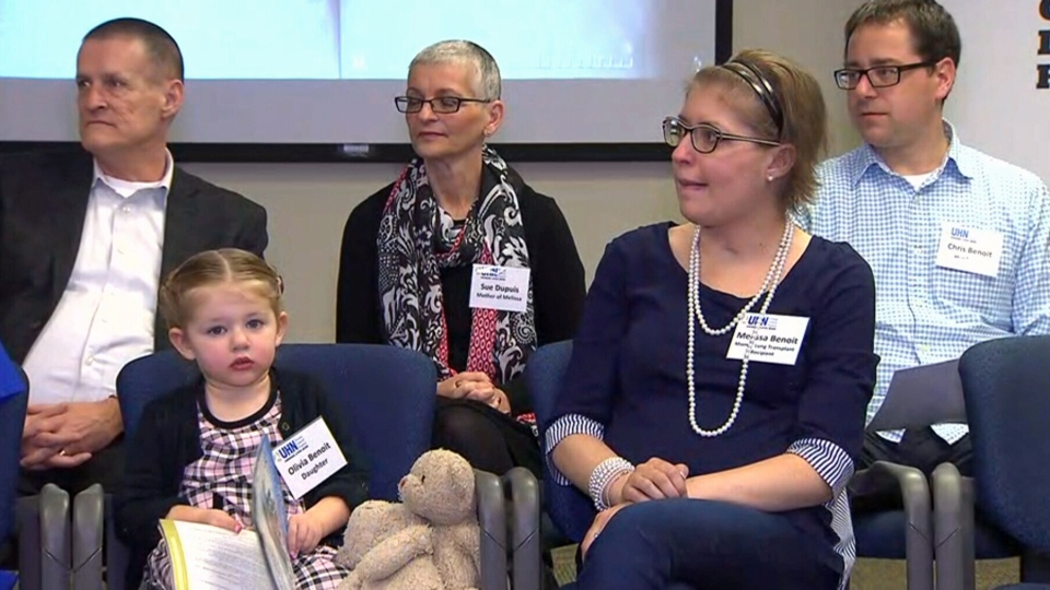 Lung transplant survivor Melissa Benoit is seen sitting next to her daughter in this image taken from video.
