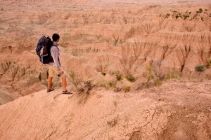 This file photo shows a hiker at Badlands National Park, S.D. (AP / South Dakota Tourism, Chad Coppess)