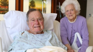 In this photo provided by Office of George H.W. Bush on Monday Jan. 23, 2017, former President George H.W. Bush and his wife Barbara pose for a photo at Houston Methodist Hospital in Houston. (Courtesy the Office of George H.W. Bush via AP)
