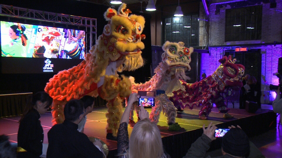 Traditional Chinese dragon dancers perform in the Horticulture Building at Lansdowne Park in Ottawa, Jan. 25, 2017