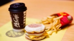A McDonald's Egg McMuffin, french fries and a coffee are shown in a handout photo. (THE CANADIAN PRESS/HO-McDonald's Canada)