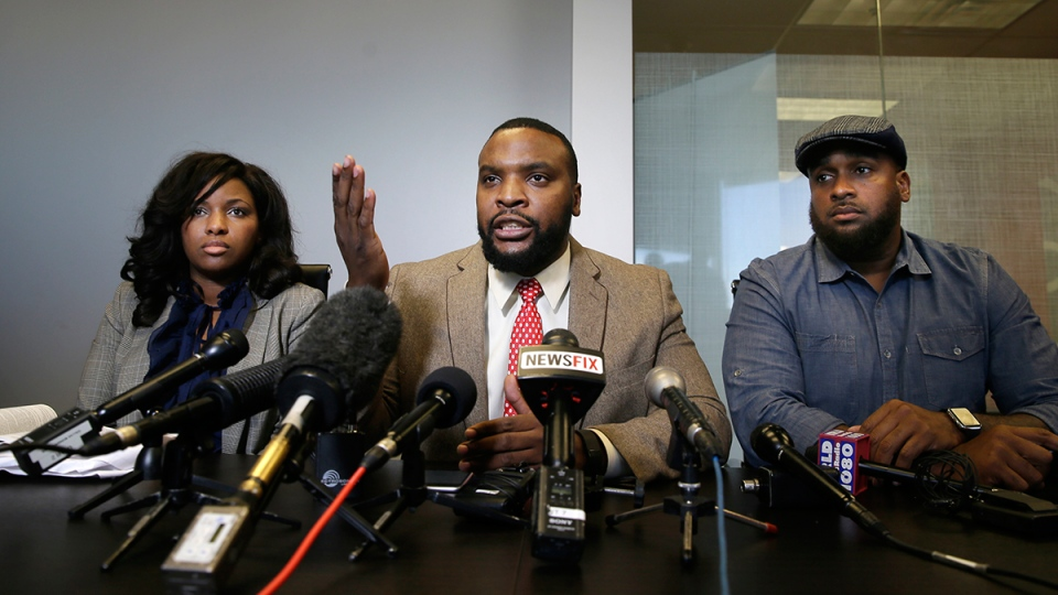 Attorney Lee Merritt, centre, speaks while his law partner attorney Jasmine Crockett, left, and as civil rights activist Cory Hughes listens during a news conference in Dallas, Thursday, Jan. 26, 2017. (AP / LM Otero)