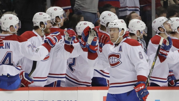 Shea Weber gives teammates a high-five after scoring against the New York Islanders, Thursday, Jan. 26, 2017. (AP Photo/Frank Franklin II)