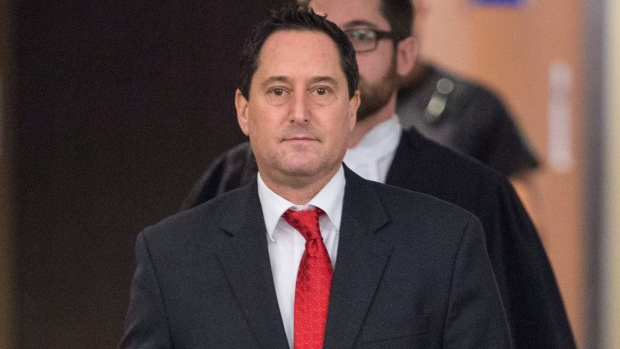 Former Montreal mayor Michael Applebaum leaves a courtroom following a verdict in Montreal on Thursday, January 26, 2017. (Paul Chiasson / THE CANADIAN PRESS)