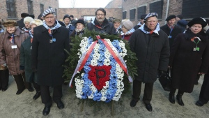 Holocaust survivors commemorate the people killed by the Nazis at the former Auschwitz Germany Nazi death camp in Oswiecim, Poland on the International Holocaust Remembrance Day that marks the liberation of the Auschwitz Nazi death camp on Jan. 27, 1945, in this photo taken on Friday, Jan. 27, 2017. (AP / Czarek Sokolowski)
