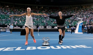 Bethanie Mattek-Sands, right, of the U.S. and Lucie Safarova of the Czech Republic perform a dance as they celebrate after defeating Andrea Hlavackova of the Czech Republic and Peng Shuai of China in the women's doubles final at the Australian Open tennis championships in Melbourne, Australia, Friday, Jan. 27, 2017. (AP / Aaron Favila)