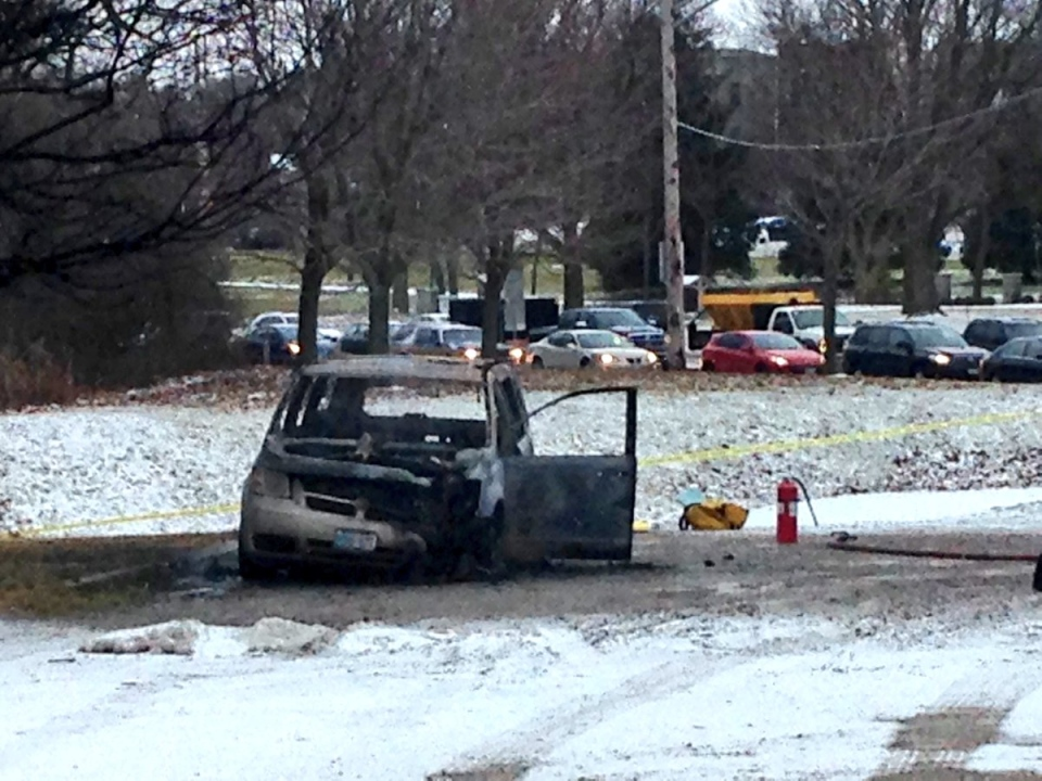 A van caught fire in a parking lot near Wonderland Road North and Riverside Drive in London, Ont, on Friday, Jan. 27, 2017. (Natalie Quinlan / CTV London)