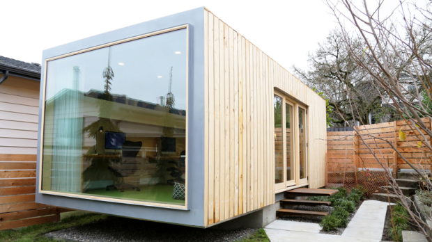 Call it thinking inside the box: With the help of a container company, crane operator and some creative designs, New Westminster, B.C., architect Randy Bens transformed a corrugated 40-foot steel shipping box into a 13,000 pound backyard office for his company. (Photos by Randy Bens Architect)