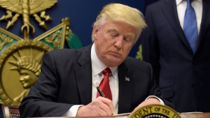 U.S. President Donald Trump signs an executive order on extreme vetting during an event at the Pentagon in Washington, Friday, Jan. 27, 2017. (AP / Susan Walsh)