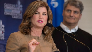 Conservative interim Leader Rona Ambrose responds to reporters questions at the end of a national caucus meeting, Friday, January 27, 2017 in Quebec City. MP Gerard Deltell, right, looks on. THE CANADIAN PRESS/Jacques Boissinot