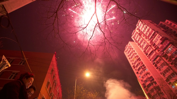Residents set off fireworks on the eve of Lunar New Year in Beijing, China, Friday, Jan. 27, 2017. (AP / Ng Han Guan)