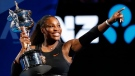 United States' Serena Williams holds her trophy after defeating her sister Venus during the women's singles final at the Australian Open tennis championships in Melbourne, Australia, Saturday, Jan. 28, 2017. (AP Photo/Dita Alangkara)
