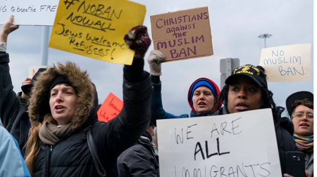 Protesters assemble at John F. Kennedy International Airport in New York, Saturday, Jan. 28, 2017 after two Iraqi refugees were detained while trying to enter the country. (AP Photo/Craig Ruttle)