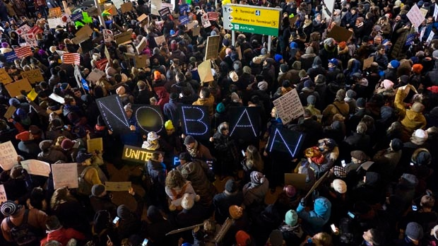 Protesters assemble at John F. Kennedy International Airport in New York, Saturday, Jan. 28, 2017, after earlier in the day two Iraqi refugees were detained while trying to enter the country. (AP Photo/Craig Ruttle)