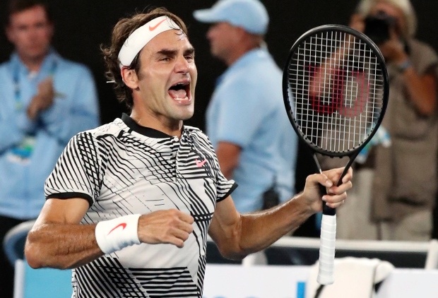 Roger Federer celebrates after defeating Rafael Nadal during the men's singles final at the Australian Open tennis championships in Melbourne, Australia, Sunday, Jan. 29, 2017. (AP / Aaron Favila)