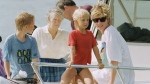 FILE - In this Jan. 4, 1993 file photo, Princess Diana and sons Harry and William at Banana Bay Beach, St. Kitts. Harry and William said on Sunday, Jan. 29, 2017, that they plan to build a statue to mark the 20th anniversary of Diana's death in a Paris car crash in 1997. (AP Photo/Richard Drew, File)