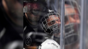 Singer Justin Bieber, who is playing for Team Gretzky, is pushed into the glass by Chris Pronger of Team Lemieux during the first period of the NHL All-Star Celebrity Shootout at Staples Center, Saturday, Jan. 28, 2017, in Los Angeles. (AP / Mark J. Terrill)