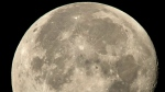The International Space Station is seen in silhouette as it transits the moon at roughly five miles per second, Sunday, Aug. 2, 2015, in Woodford, Va. (/Bill Ingalls/NASA via A)