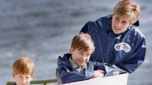 Diana, Princess of Wales, enjoys a ride on the Maid of Mist in Niagara Falls, Ont., in this Oct., 1991, photo, with her sons Prince Harry, then 7, and Prince William, then 9. THE CANADIAN PRESS/Hans Deryk