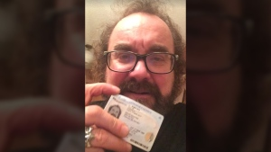 Dave Balay of Camrose, Alta., is shown with his cracked licence. (Facebook / Dave Balay)