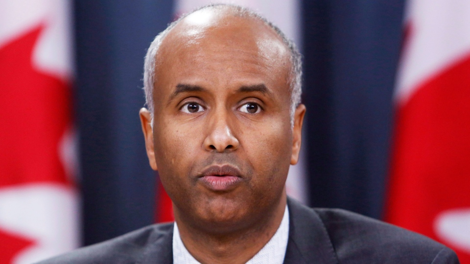 Ahmed Hussen, Minister of Immigration, Refugees and Citizenship, holds a news conference to update Canadians on the possible impacts of recent immigration-related decisions made by President Donald Trump, in Ottawa on Sunday, January 29, 2017. (Fred Chartrand/The Canadian Press)