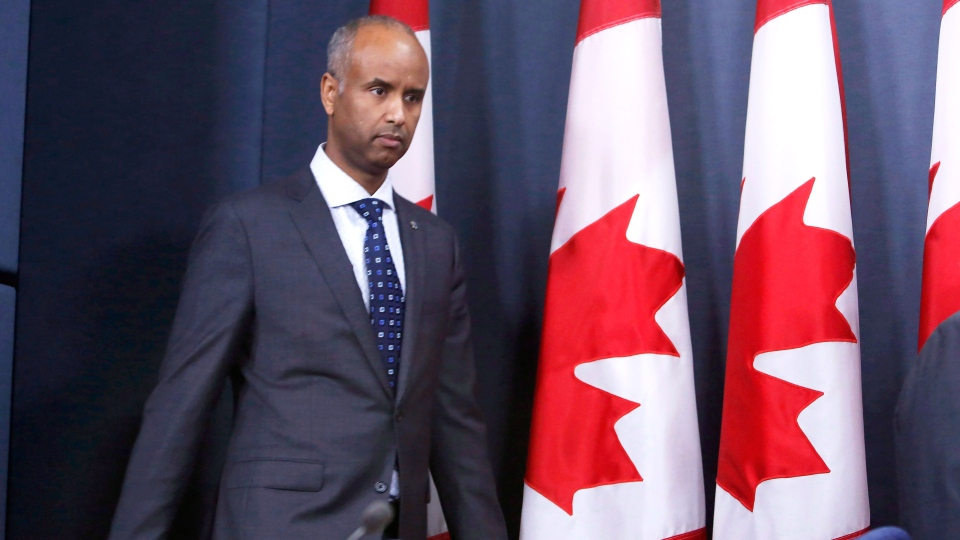 Ahmed Hussen, Minister of Immigration, Refugees and Citizenship arrives at a news conference to update Canadians on the possible impacts of recent immigration-related decisions made by President Donald Trump, in Ottawa on Sunday, January 29, 2017. THE CANADIAN PRESS/Fred Chartrand