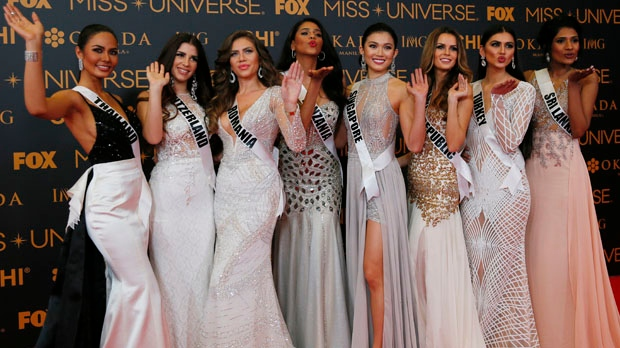 Miss Universe contestants blow kisses to photographers as they pose on the red carpet on the eve of their coronation Sunday, Jan. 29, 2017, at the Mall of Asia in suburban Pasay city south of Manila, Philippines. (AP Photo/Bullit Marquez)