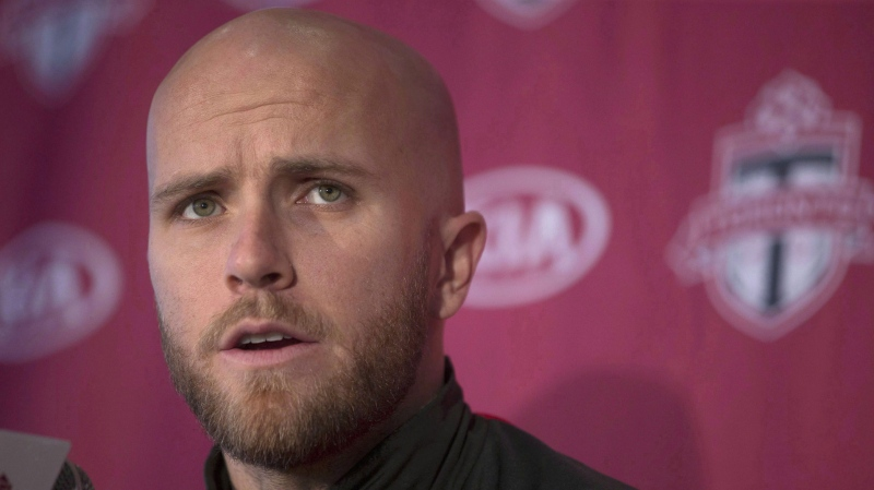 """U.S. soccer captain and Toronto F.C. skipper Michael Bradley says he is """"sad and embarrassed"""" by President Donald Trump's travel ban. Bradley attends a season wrapping news conference, in Toronto in a December 13, 2016, file photo. THE CANADIAN PRESS/Chris Young"""