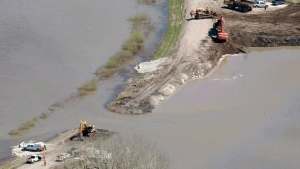 The breach in the dike at the hoop and holler bend is seen along the Assiniboine River outside of Portage La Prairie, Man, Saturday, May 14, 2011. (THE CANADIAN PRESS/Jonathan Hayward)
