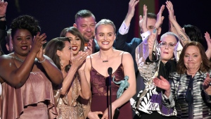 """Taylor Schilling, centre, and the cast of """"Orange Is the New Black"""" accept the award for outstanding performance by an ensemble in a comedy series at the 23rd annual Screen Actors Guild Awards at the Shrine Auditorium & Expo Hall in Los Angeles, on Sunday, Jan. 29, 2017. (Photo by Chris Pizzello/Invision/AP)"""