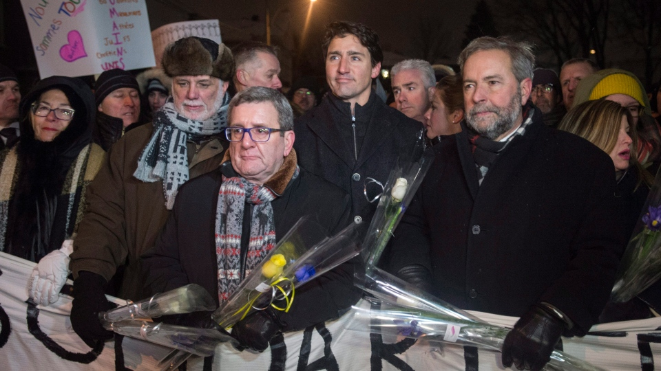 Quebec Premier Philippe Couillard, Quebec City mayor Regis Labeaume, Prime Minister Justin Trudeau and NDP Leader Thomas Mulcair lead a march during a vigil, in in Quebec City, on Monday, January 30, 2017. (THE CANADIAN PRESS/Paul Chiasson)