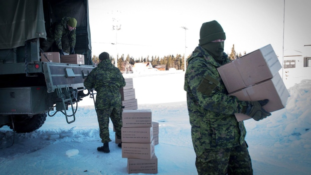 Canadian Army soldiers from Gagetown, N.B. unload supplies on Miscou Island, Monday, January 30, 2017 helping northeastern New Brunswick recover from a devastating ice storm that has been linked to two deaths and almost three dozen hospitalizations from carbon monoxide poisoning. (THE CANADIAN PRESS/Diane Doiron)