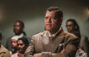 """This image released by BET shows Laurence Fishburne as Nelson Mandela in a scene from, """"Madiba,"""" a six-hour miniseries premiering on Wednesday, Feb. 1. (Marcos Cruz/BET via AP)"""