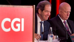 CGI Chairman Serge Godin, left, and chief executive Michael Roach get set to start the company's annual meeting Wednesday, January 28, 2015 in Montreal. (Ryan Remiorz/The Canadian Press)