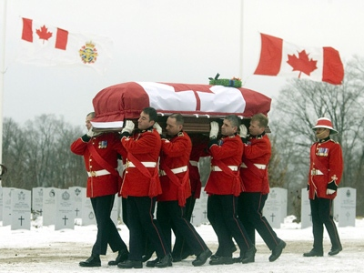 Military pallbearers carry the casket of Warrant Officer Robert Girouard during a military funeral at Beechwood Military Cemetary in Ottawa Wednesday, December 6, 2006. (Fred Chartrand / THE CANADIAN PRESS)