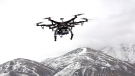 In this Feb. 13, 2014 file photo, members of the Box Elder County Sheriff's Office fly their search and rescue drone during a demonstration, in Brigham City, Utah. (Rick Bowmer, File/AP Photo)